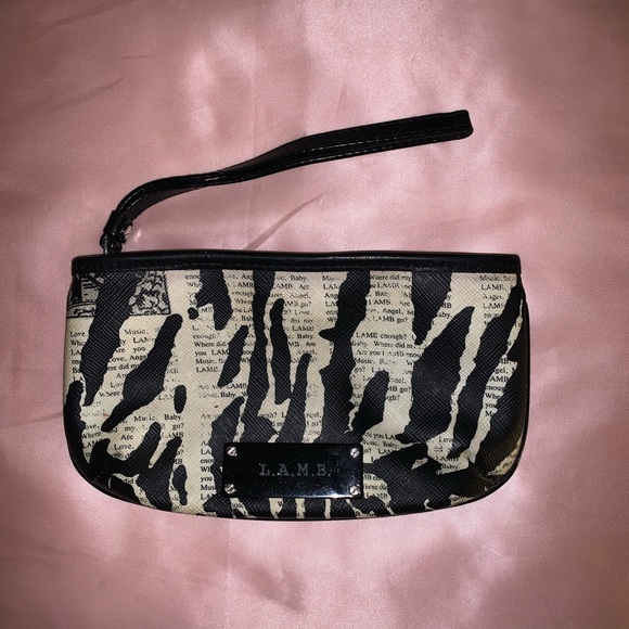 L.A.M.B. Handbags - L.A.M.B. Newspaper Zebra Print Clutch 🦓